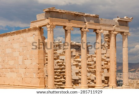The Parthenon - is a former temple on the Athenian Acropolis, Greece, dedicated to the goddess Athena, whom the people of Athens considered their patron. Athens, Greece. - stock photo