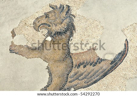 the partial portrait of a mythical gryphon in the remains of the great palace of constantinople - stock photo