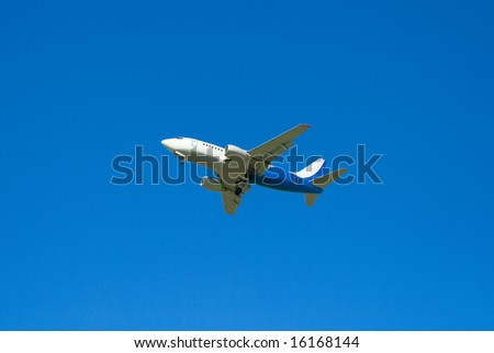 The passenger plane on a background of the dark blue sky