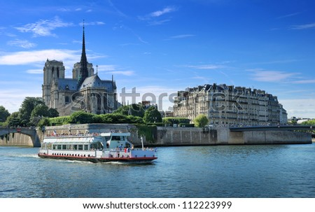The passenger ship on river Seine near to island Cite in Paris, France. - stock photo