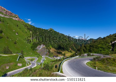 The Passo Fedaia is a mountain pass traversed by a paved road in the Dolomiti Range in Northern Italy. - stock photo