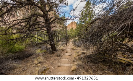 The path among the rocks. Stairs in the forest. Beautiful landscape of yellow sharp cliffs.  Smith Rock state park, Oregon