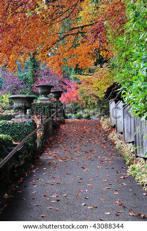 The path inside historic butchart gardens in autumn, vancouver island, british columbia, canada - stock photo