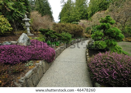 The path inside historic butchart gardens in autumn, vancouver island, british columbia, canada