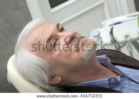 The patient in the dentist's chair is waiting Curative procedures - stock photo
