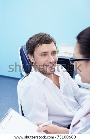 The patient on admission to the dental office - stock photo