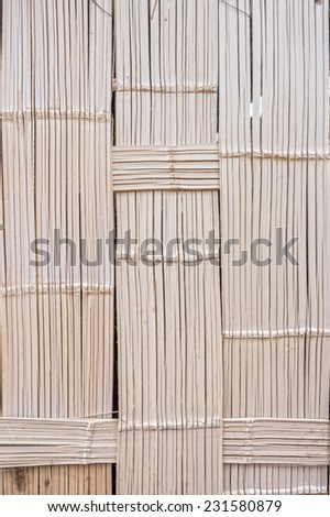 The pattern of bamboo weave wall of traditional bungalow house in countryside, Thailand - stock photo
