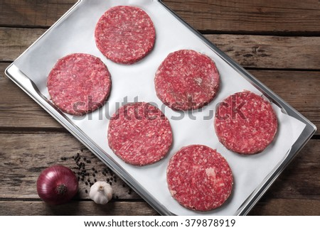 The patties of minced meat on a tray - stock photo