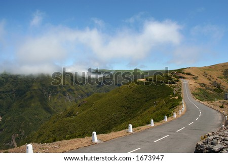The Paul De Serras plateau, Madeira, has an average height of 1200+ metres. The cloud levels are often below the top of the plateau so you feel like its the top of the world. - stock photo