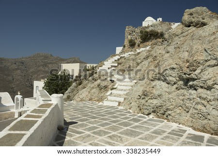 The paved path leading to the little white church which stands at the highest point of the town of Serifos island, Greece