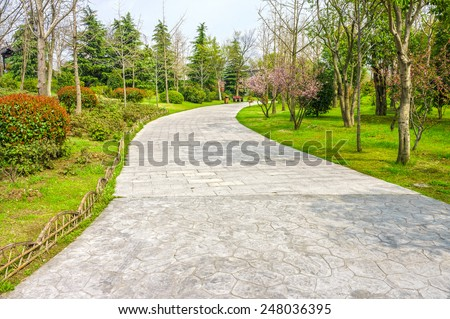 The pavement way in a garden - stock photo