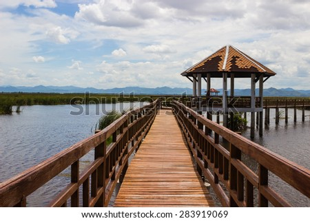 the pavilion on lake and blue sky background - stock photo