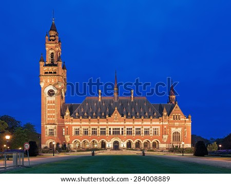 The Peace Palace at evening in The Hague, Netherlands. It houses the International Court of Justice of UN, the Permanent Court of Arbitration and the Hague Academy of International Law. - stock photo