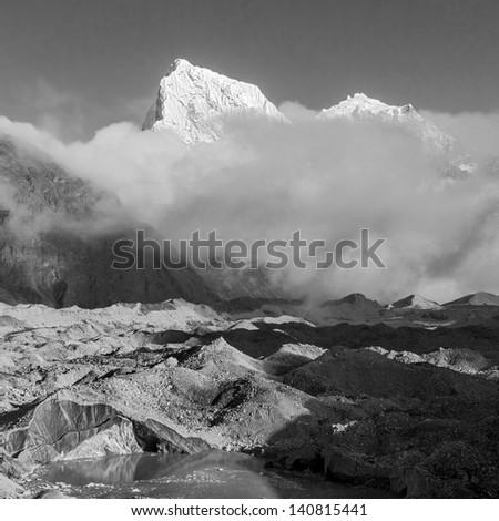The peak Cholatse (6335 m) and Gokyo glacier - Gokyo region, Nepal, Himalayas (black and white) - stock photo