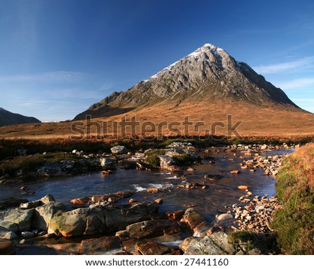 The peak of Buachaille Etive Mor above River Coupall - stock photo