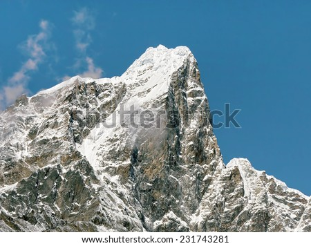 The peak Tabuche from the village Dingboche in the valley Chhukhung - Nepal, Himalayas - stock photo