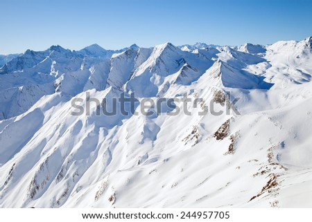 the peaks of the mountain range in winter, the Alps - stock photo