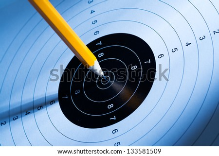The pen hits the target, think and act for success - stock photo