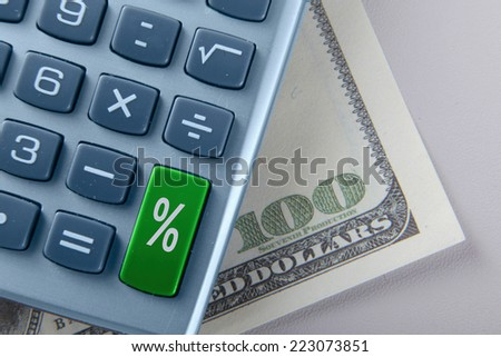 The percent calculator and dollars - stock photo