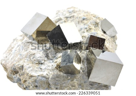 The perfect cube of Pyrite in matrix, The mineral pyrite, or iron pyrite, also known as fool's gold, is an iron sulfide - stock photo