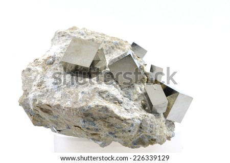 The perfect cube of Pyrite in matrix, The mineral pyrite, or iron pyrite, also known as fool's gold, is an iron sulfide