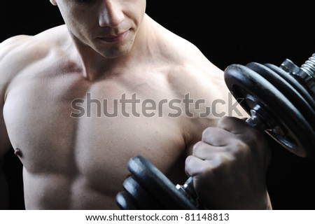 The Perfect male body - Awesome bodybuilder posing with dumbbells - stock photo