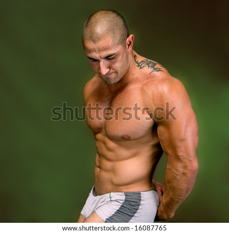 The Perfect male body isolated on  green background - stock photo
