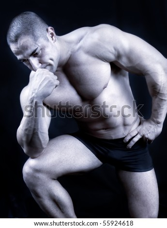 The Perfect muscular man posing , black and white shot - stock photo