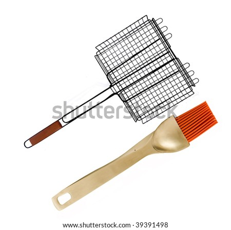 THE PERFECT PAIR -GRILLING BASKET WITH BASTE BRUSH - stock photo