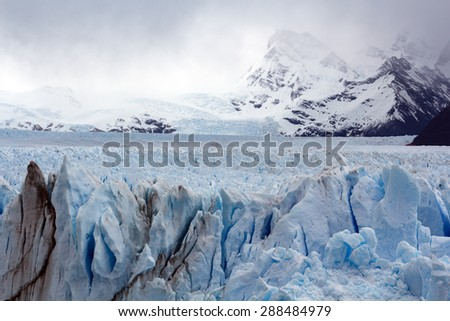 The Perito Moreno Glacier is a glacier located in the Los Glaciares National Park in Santa Cruz Province, Argentina. It is one of the most important tourist attractions in the Argentinian Patagonia. - stock photo