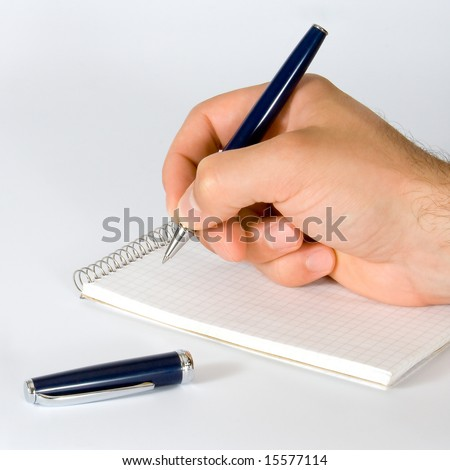 The person doing note in a notebook.