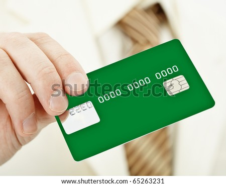 The person holds a green electronic plastic card in a hand - stock photo