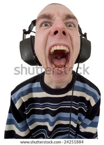 The person in ear-phones shouting at a white background - stock photo