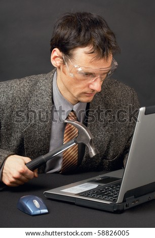 The person repairs the laptop as is able - stock photo