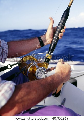 The person who goes fishing on the ship and blue sky. - stock photo