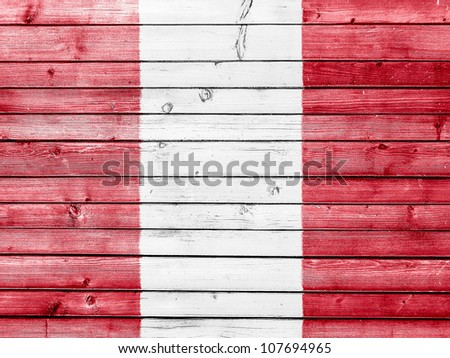 The Peru flag painted on wooden fence - stock photo