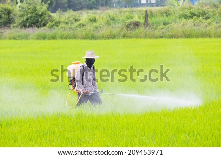 The pesticides , Farmer spraying pesticide - stock photo