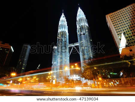 The Petronas Twin Towers, at the heart of the Kuala Lumpur city - stock photo