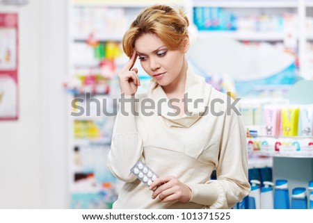 The pharmacist at the pharmacy of pills - stock photo