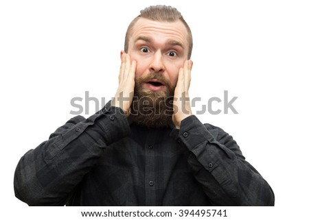 The photo depicts a bearded man on a white background