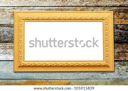 The photo frame on wood background - stock photo