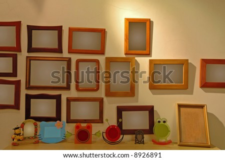The photo frames hanging on a wall of a house