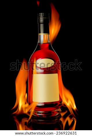 The photo of cognac on table in front of fireplace - stock photo