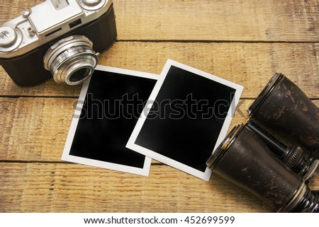 The photo papers on the wood table - stock photo