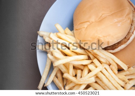 The photo shows potatoes and sandwich on table