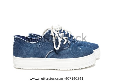 The photo shows the shoes on a white background