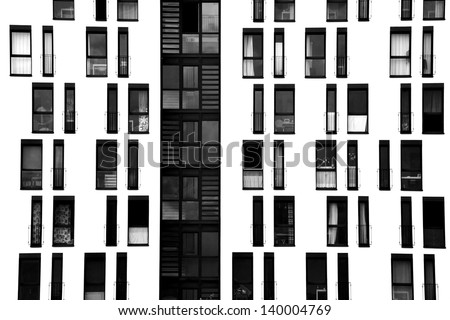 The photograph of a facade with symmetrically arranged windows/window facade - stock photo