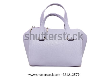 The photograph shows a female handbag on a white background