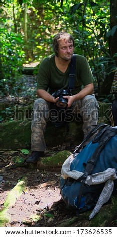 The photographer in the jungle on a halt. Republic of Congo. Africa
