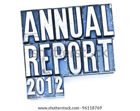 The phrase Annual Report in letterpress type. Cross processed, narrow focus. - stock photo